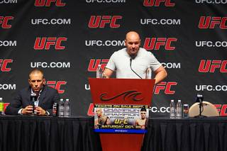 Georges St. Pierre and Dana White take part in a news conference to announce the card for UFC 137 on Wednesday, Sept. 7, 2011, at Mandalay Bay Events Center. Nick Diaz was slated to face St. Pierre but was pulled from the fight and replaced with Carlos Condit due to multiple failed media appearances, missed company flights and general disappearance.