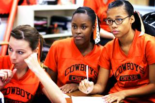 Seniors Crystal Carter, center, and Elsha Harris, right, listen during a student council meeting at Chaparral High School in Las Vegas on Thursday, Sept. 8, 2011.