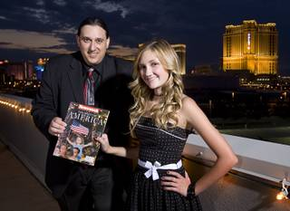 Former Las Vegas Sun photographer Ethan Miller and Alana Milawski, 13, pose with a copy of Newsweek' s Spirit of America commemorative issue after a 9/11 Remembrance opening event Friday, Sept. 9, 2011. Milawski was 3 years old when Miller photographed her on her father's shoulders during a candlelight vigil at the Thomas & Mack Center on Sept. 12, 2001.