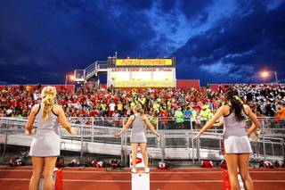 Banners are on display and Arbor View fans wear fluorescent colors during a game against Centennial on Friday, Sept. 9, 2011, in honor of 15-year-old Alyssa Otremba, an Arbor View sophomore and band member, found slain last week.