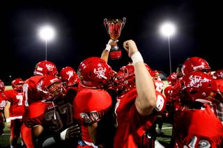 Arbor View holds up the rivalry trophy after its 20-13 win over Centennial on Friday, Sept. 9, 2011.