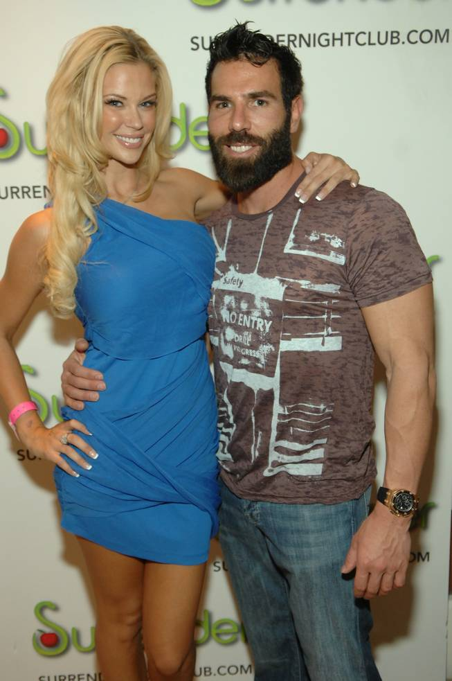 "Miss July Playboy Playmate Jessa Lynn Hinton and poker star Dan Bilzerian at ""Robin Leach: 50 Years of Celebrity Journalism"" at Encore Beach Club and Surrender at the Encore on Sept. 9, 2011."