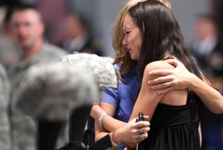 Master Sgt. Christian Riege's fiance Stacia Greene is consoled by an unidentified friend before a memorial ceremony in Carson City on Sunday, Sept. 11, 2011. Three Nevada National Guard members who were killed by a gunman in an IHOP restaurant were honored during the private ceremony.
