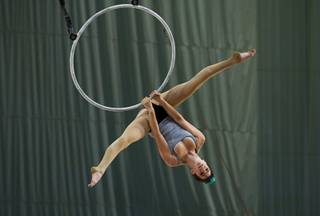 Rachel Stewart performs a routine with a hoop during auditions for new Cirque du Soleil performers in the