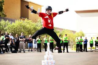 Cory Patton of Greenwood, Louisiana performs his finale move, jumping over a pyramid stack of SONIC cups, during the So You Think You Can Skate freestyle finals, part of the 2011 Dr. Pepper SONIC Games held at a SONIC Drive-In on E. Lake Mead Parkway in Henderson Monday, September 12, 2011.