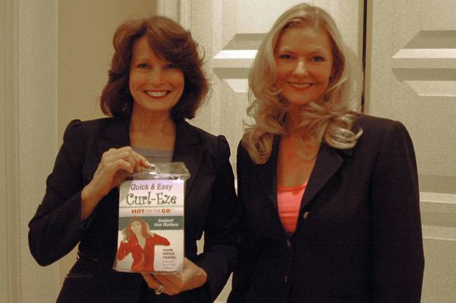 Debra Weisser (right) of Tampa Bay, Fla., poses with her invention, Curl-Eze, during TeleBrands' Inventors Day event at Encore on Sept. 12, 2011. With her is Lana Lum, who handles marketing for the product.