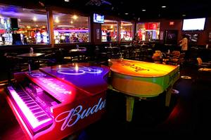 "A view of ""dueling pianos"" at the Swingers Club inside the newly-renovated Plaza Hotel and Casino in downtown Las Vegas Wednesday, September 14, 2011."