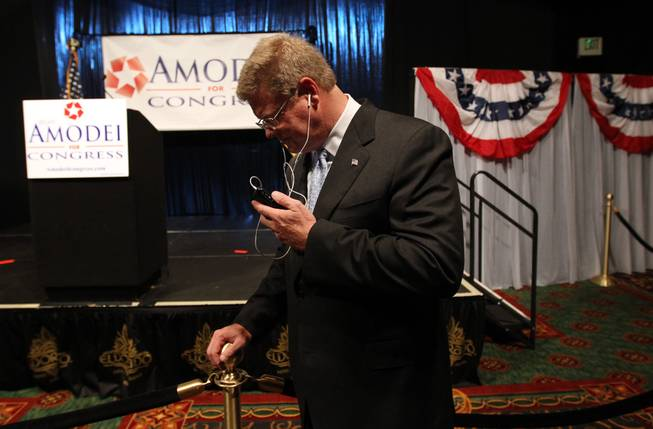 Former Republican state senator Mark Amodei takes a phone call from the National Republican Committee chairman after taking the lead in Nevada's special election to fill a U.S. House seat, during an election night event in Reno on Tuesday Sept. 13, 2011.