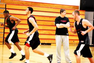UNLV men's basketball coach Dave Rice watches as the team runs sprints during its first workout of the fall on the UNLV campus Thursday, Sept. 15, 2011.