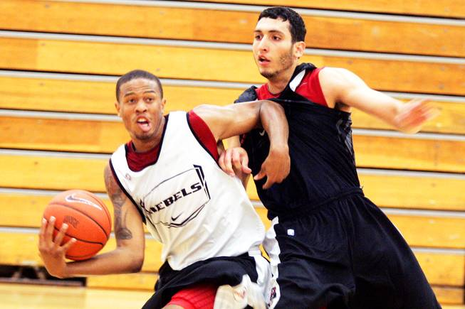 UNLV sophomore guard Bryce Jones, left, works against sophomore forward Karam Mashour during the first team workout of the fall on the UNLV campus Thursday, Sept. 15, 2011.