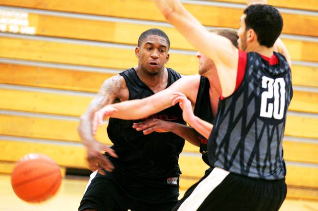 UNLV senior guard Oscar Bellfield (left) and sophomore forward Karam Mashour (20) defend against senior guard Kendall Wallace during the first team workout of the fall on the UNLV campus Thursday, Sept. 15, 2011.