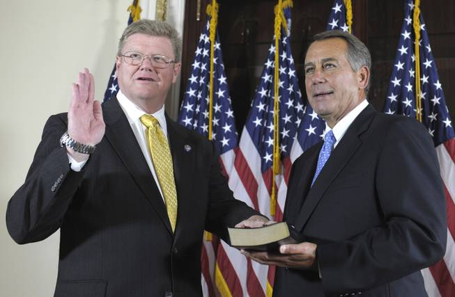House Speaker John Boehner of Ohio, right, administers the House Oath to Rep. Mark Amodei, R-Nev., on Capitol Hill in Washington, Thursday, Sept. 15, 2011, during a ceremonial swearing-in ceremony, following his official swearing in on the floor of the House.