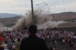 A P-51 Mustang airplane crashes into the edge of the grandstands at the Reno Air show on Friday, Sept. 16, 2011. The World War II-era fighter plane flown by a veteran Hollywood stunt pilot Jimmy Leeward plunged Friday into the edge of the grandstands during the popular air race creating a horrific scene strewn with smoking debris.
