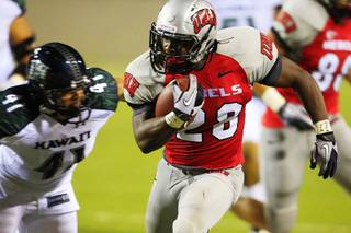 UNLV's Bradley Randle is chased down by  Hawaii's Corey Paredes during the first half of UNLV's home opener Saturday, Sept. 17, 2011.