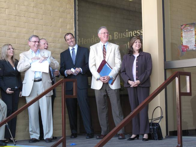 City of Henderson and Henderson Chamber of Commerce officials celebrate the 10th anniversary of the Henderson Business Resource Center. From left are Rebecca Fay, the center's director, Wells Fargo Bank Regional President Kirk Clausen, USAA Savings Bank President Larry Seedig, chamber President Scott Muelrath, Mayor Andy Hafen and Councilwoman Gerri Schroder.
