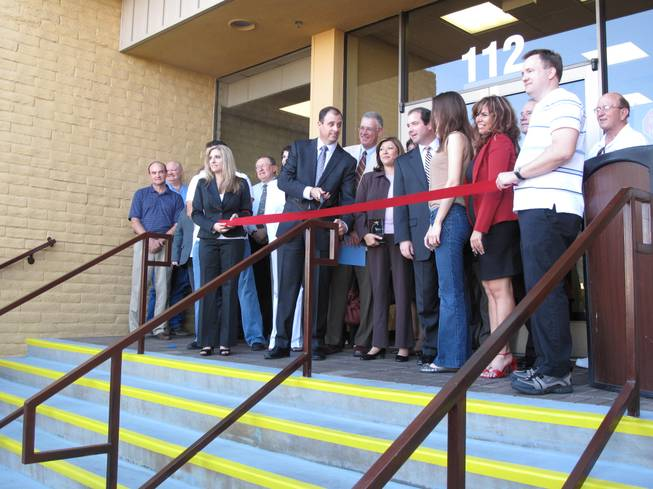 Henderson business leaders and city officials, led by Chamber of Commerce president Scott Muelrath, cut a ribbon during the 10th anniversary celebration for the Henderson Business Resource Center.