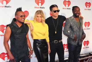 The Black Eyed Peas -- Will.i.am, Fergie, Taboo and Apl.De.Ap -- at the iHeartRadio Music Festival at MGM Grand Garden Arena on Sept. 23, 2011. On New Year's Eve, Fergie will host the grand opening of 1 OAK Nightclub at the Mirage, while Will.i.am will spin at Surrender at two of the many Las Vegas NYE celeb-studded parties.