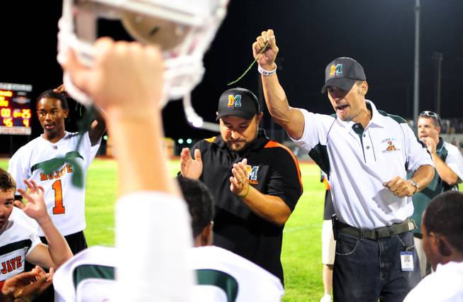 Mojave High School Principal Antonio Rael holds up a broken green wristband symbolizing breaking negative perceptions at his school with the Rattler's first win since the 2009-10 season on Friday, Sept. 24, 2011, against the Boulder City Eagles during their homecoming weekend.