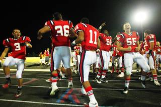 Liberty players celebrate their 26-20 win over Silverado with a haka Friday, September 23, 2011.