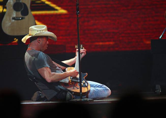 Kenny Chesney performs during the second night of the iHeartRadio Music Festival at MGM Grand Garden Arena on Saturday, Sept. 24, 2011. The festival marks the official launch of iHeartRadio, Clear Channel's free digital radio product combining more than 800 broadcast radio and digital-only stations from 150 cities.