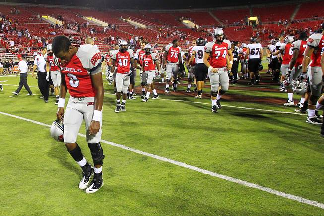 UNLV quarterback Caleb Herring walks off the field after losing to Southern Utah University 41-16 Saturday, September 24, 2011.