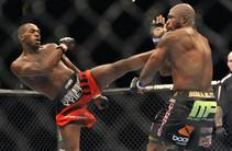 Jon Jones, left, of Endicott, N.Y., gets in a kick to the head of Rampage Jackson, of Irvine, Calif., during the first round of their ...