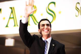Ruben Kihuen waves to the crowd during his campaign kickoff celebration at Rancho High School in Las Vegas on Tuesday, Sept. 27, 2011. Kihuen, who is a state senator, is running for Congress in 2012.