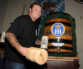 Corey Harrison taps the keg for Oktoberfest at Hofbrauhaus on Sept. 30, 2011.