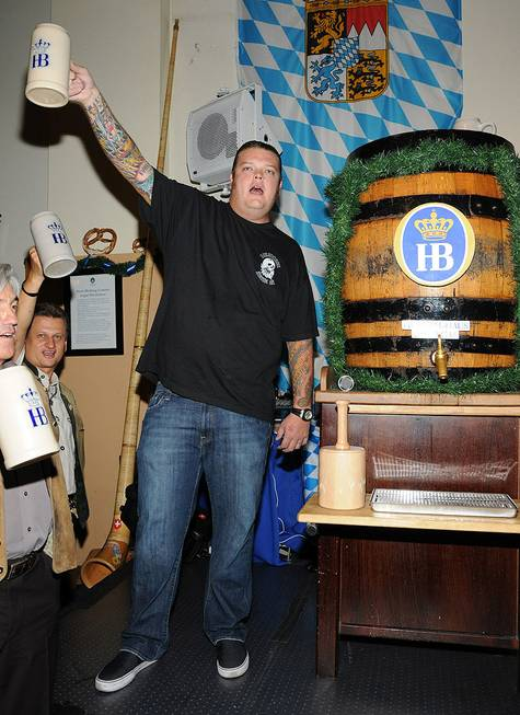 Corey Harrison taps the keg for Oktoberfest at Hofbrauhaus on ...