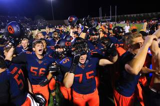 Bishop Gorman players celebrate their 31-28 win over Servite Friday, Sept. 30, 2011.