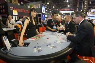 Tala Marie deals a game called Cincinnati 7 Card Stud at a Shuffle Master booth during the first day of the Global Gaming Expo (G2E) convention at the Sands Expo Center Tuesday, Oct. 4, 2011.
