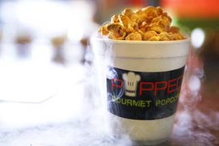 Frozen caramel popcorn is made with liquid nitrogen at Popped, a gourmet popcorn shop on Eastern Avenue, on Wednesday, Oct. 5, 2011.