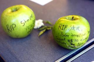A small shrine to Steve Jobs is displayed in the window of the Apple Store in Town Square Las Vegas Friday, October 7, 2011.