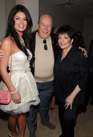 Laura Croft and Robin Leach attend Liza Minnelli's meet-and-greet at the Las Vegas Hilton on Oct. 7, 2011.