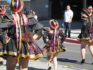 Young girls dance to Bolivian music representing the country in the annual Hispanic International Day Parade.