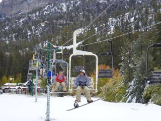 Snowboarders and skiiers hit the slopes as the Las Vegas Ski & Snowboard Resort opens Saturday, Oct. 8, 2011.