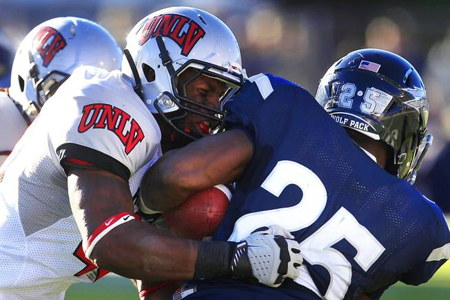 UNLV linebacker Princeton Jackson tackles UNR running back Stefphon Jefferson during their game Saturday, Oct. 8, 2011, at Mackay Stadium in Reno. UNR won the game 37-0 to extend its winning streak over UNLV to seven.