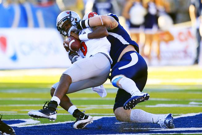 UNLV quarterback Caleb Herring gets sacked by UNR during the first half of their game Saturday, Oct. 8, 2011, at Mackay Stadium in Reno.