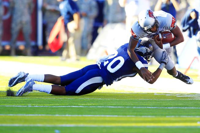 UNLV quarterback Caleb Herring is taken down for a loss by UNR defensive back Duke Williams during the first half of their game Saturday, Oct. 8, 2011, at Mackay Stadium in Reno.