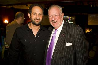 Screenwriter Dustin Abraham poses with former Las Vegas Mayor Oscar Goodman during a