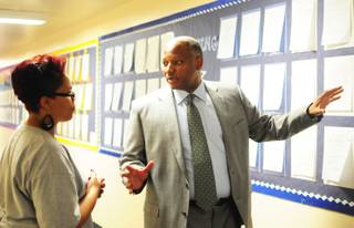 Clark County Schools Superintendent Dwight Jones shares an idea with Principal Amber Brookins at Jacobson Elementary School on Wednesday, Oct. 12, 2011. Jones said he hopes to take formal, one-hour tours at more than 50 schools by the end of the school year.