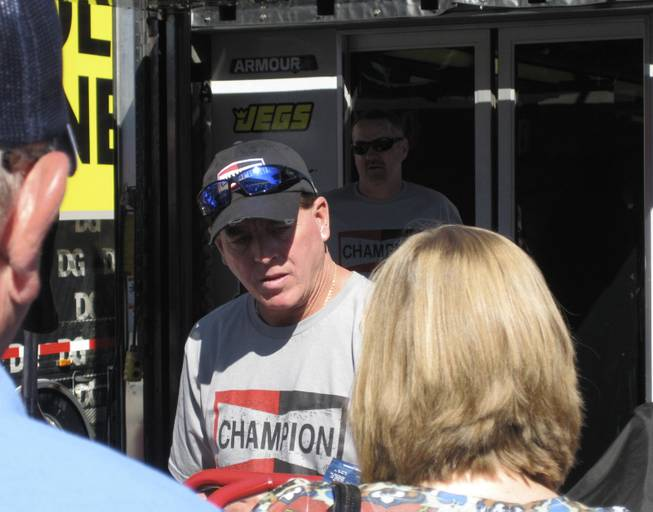 Race winner Ron Hornaday signing autographs before the race.