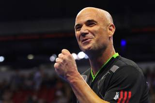 Andre Agassi celebrates a point during the Las Vegas stop of the 2011 Champions Series Tennis tournament Saturday, Oct. 15, 2011.
