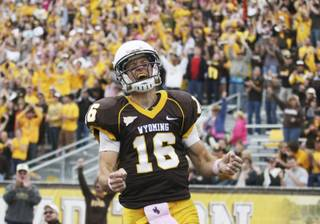 Wyoming quarterback Brett Smith celebrates his touchdown catch on a trick play during an NCAA college football game against UNLV on Saturday, Oct. 15, 2011, at War Memorial Stadium in Laramie, Wyo.