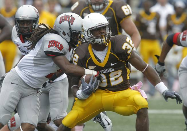 Wyoming running back Alvester Alexander navigates his way through the UNLV defense.