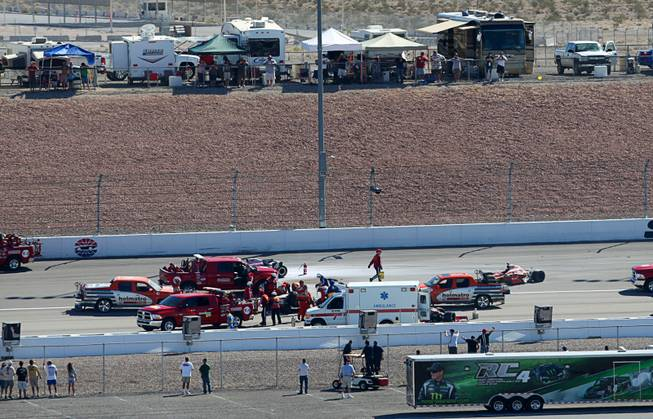 Medical and safety crews respond after a multi-car wreck during the IZOD IndyCar World Championship race at the Las Vegas Motor Speedway Sunday, October 16, 2011. IndyCar driver Dan Wheldon was killed in the crash.