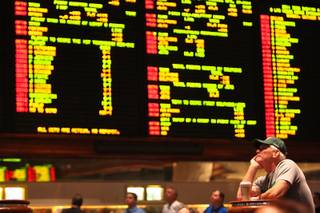 Philadelphia Eagles fan Jeff McKee of Huntington Beach, Calif., watches his team as they continue to push past the Washington Redskins on the TV monitors at the Mirage Race & Sports Book on Sunday, Oct. 16, 2011.