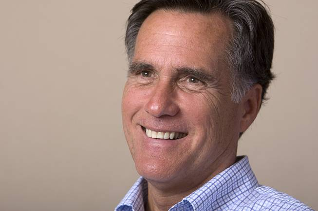 Former Massachusetts Gov. Mitt Romney smiles during an interview in Las Vegas Monday, Oct. 17, 2011.