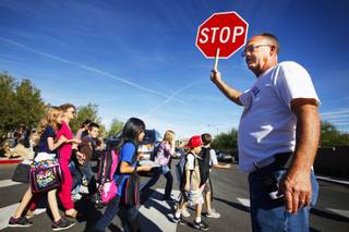 Fred Peters, the grandfather of a student, directs traffic at Paiute Peak Avenue and Gagnier Boulevard after classes at Wright Elementary School in southwest Las Vegas on Tuesday, Oct. 18, 2011.