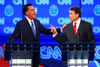 Mitt Romney and Rick Perry take part in the GOP presidential debate sponsored by CNN on Tuesday, Oct. 18, 2011, at the Venetian.
